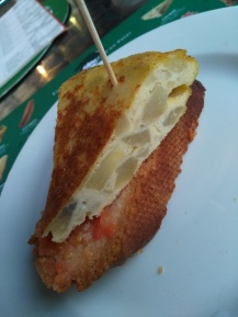 Traditional potato omelet on tomato bread