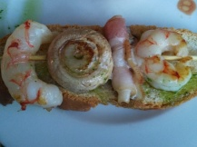 Shrimp, mushroom, bacon on toast with pesto.