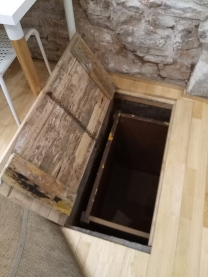 Trapdoor into the old stone cellar