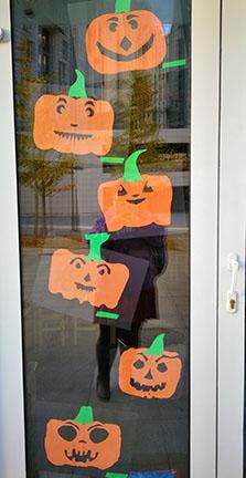 paper cut jack-o-lanterns on door